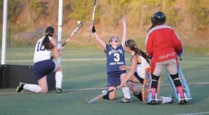 Emilie Arrix of Wilton shows the joy of an overtime winning goal as Wilton captured the class M field hockey title. John Nash - The Hour.