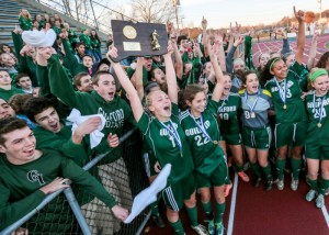 The Guilford girls soccer team celebrates with its fans after a win in the class L final. John Vanacore - New Haven Register.