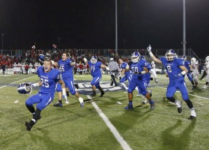 Members of the Southington football team celebrate the squad's LL championship. David Butler II - Hartford Courant.