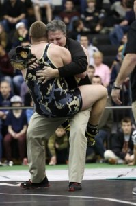 Trumbull wrestler Andrew Marino celebrates with his dad after his effort at the State Wrestling Open. Mike Ross - CT Post.