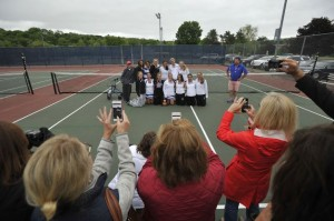 The Fairfield Ludlowe girls tennis team poses with its class L title plaque. Jason Rearick - CT Post.