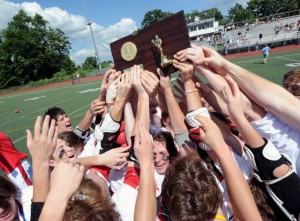 Greenwich celebrates the team's class L boys lacrosse title. Bob Luckey - Greenwich Time.