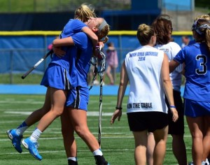 Darien's class L girls lacrosse championship warranted a hug. Christian Abraham - Darien News.