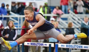 Shawn Fletcher's win in the 110-meter hurdles was part of Hillhouse's MM title effort. Catherine Avalone - New Haven Register.