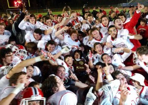 New Canaan celebrates its Class L football title. Christian Abraham - Hearst papers.