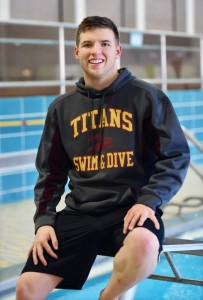 Sheehan's Connor Robison is leading his team in and out of the pool. Catherine Avalone - New Haven Register.