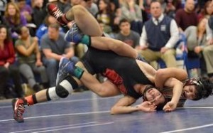 Alejandro Garcia of Windham was one of several strong performers as the team earned the Class S wrestling crown. Aaron Flaum - Norwich Bulletin.