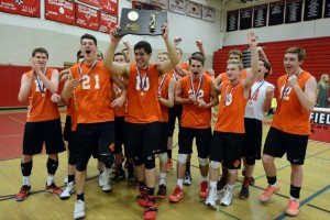 Ridgefield celebrates again after earning a third-straight Class L title. Matthew Brown - Hearst Connecticut.