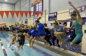 The Darien team celebrates a Class L title with a leap into the pool. Matthew Brown - Hearst Media.