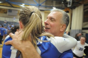 Lyman Memorial coach Marty Gomez offers a hug after his team earned the Class S volleyball title. Jimmy Zanor - Middletown Press.
